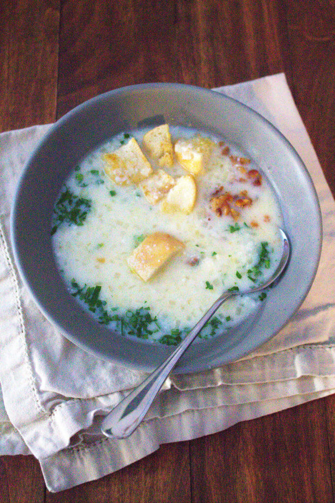 overhead view of a bowl of parmesan rind soup
