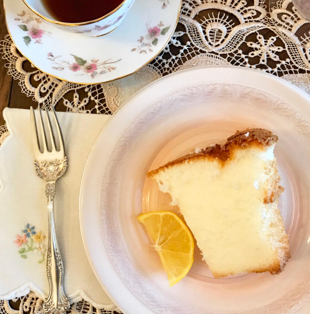 a fluffy slice of angel food cake on a pink plate at a Paris tea party
