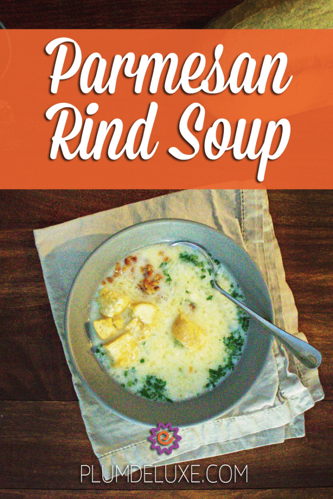 An overhead view of a bowl of parmesan rind soup