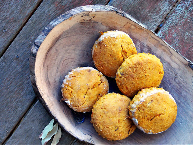 Baked sweet potato scones are served in a wooden bowl.
