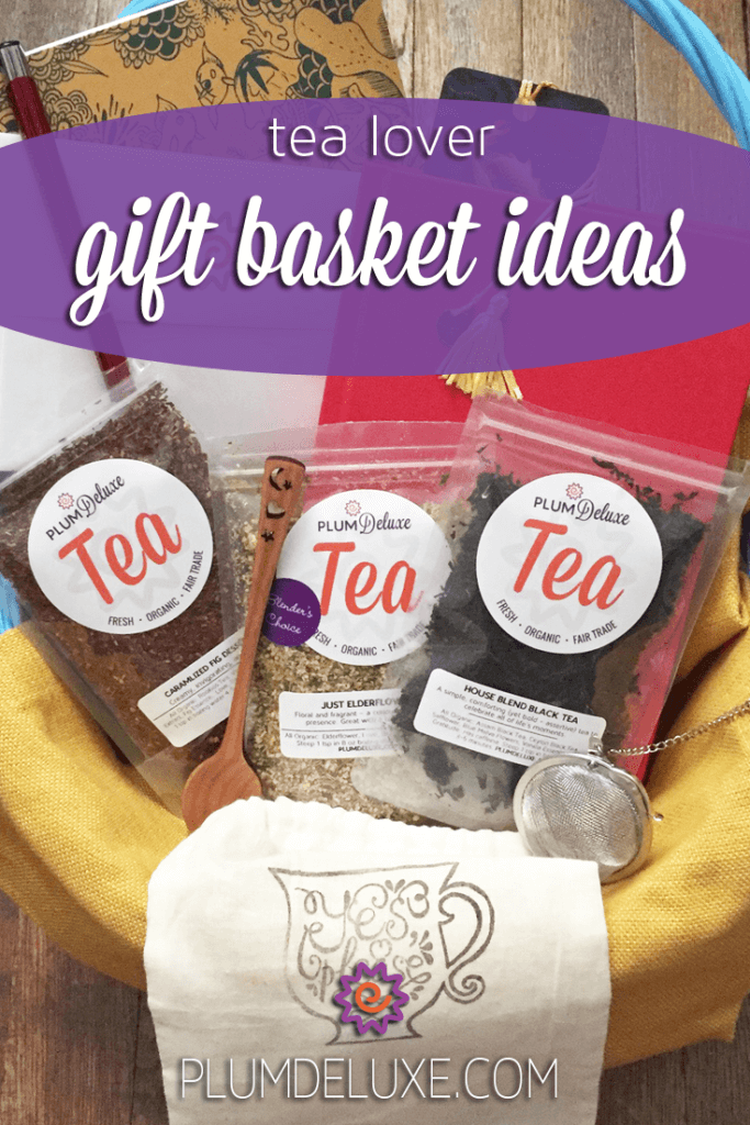 A trio of loose leaf teas, teaspoon, tea infuser, and journal are tucked into a gift basket.