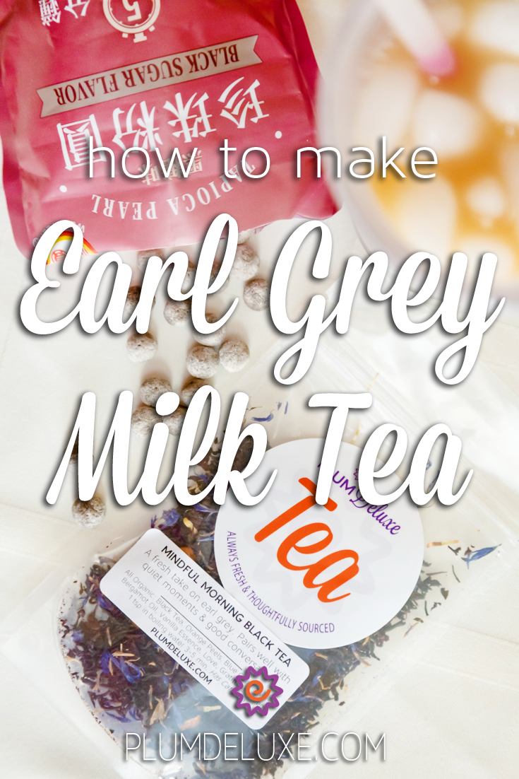 Overhead view of a bag of Plum Deluxe Earl Grey tea, and glass of iced tea with ice cubes, and a red back spilling out tapioca pearls. The overlay text reads: how to make earl grey milk tea.